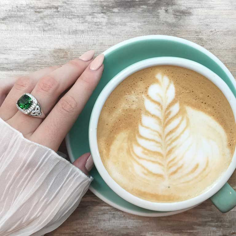 Silver Green Cz Trinity Knot Halo Ring having Coffee